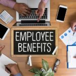 Employee Benefits surrounded by team members graphic